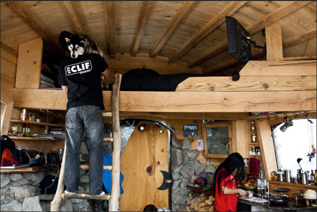 The cabin's sleeping loft and tiny kitchen.