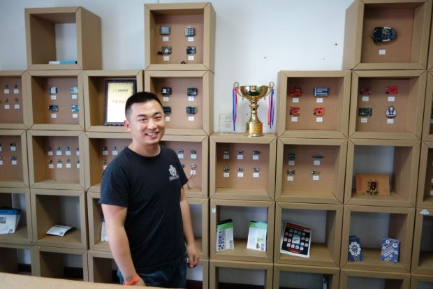 Eric Pan in front of a product display at Seeed Studio