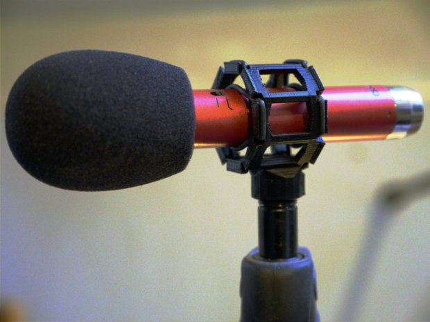The mic holder fits and screws onto microphone stand and camera hot shoe mounts well, adjust with light sanding as required. Get the file here.