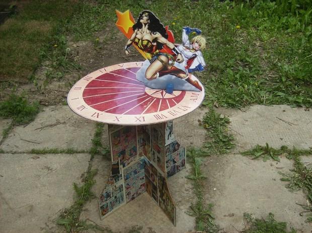 A simple cardboard Wonder Woman/Powergirl sundial design