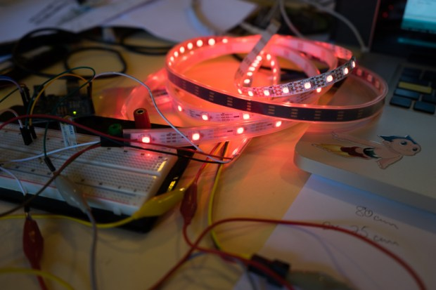 The Arduino Uno and LED strips that are housed inside the jacket.