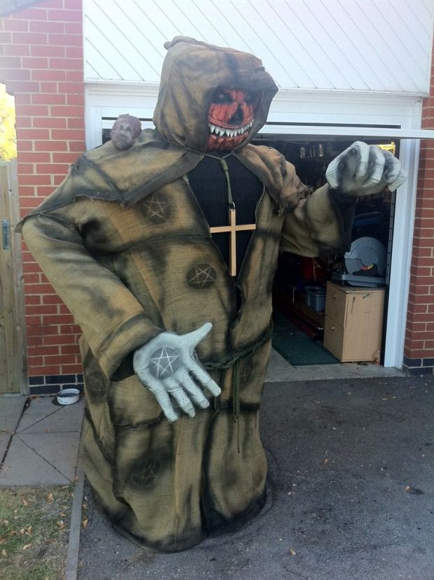 Roofletch's Keeper of the Graveyard costume stands over 8-feet tall and is made of chicken wire and old phone bills.
