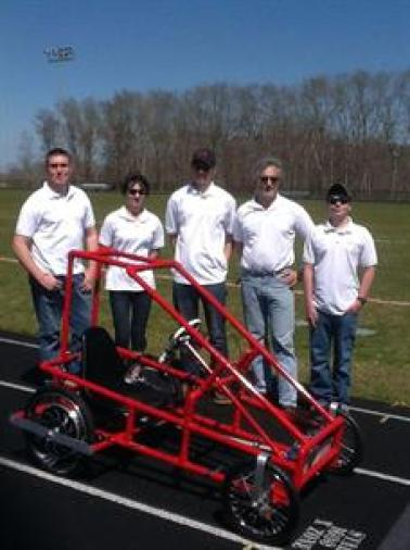 Teacher Edwin Fernandes and his students who created an electric, solar powered vehicle.