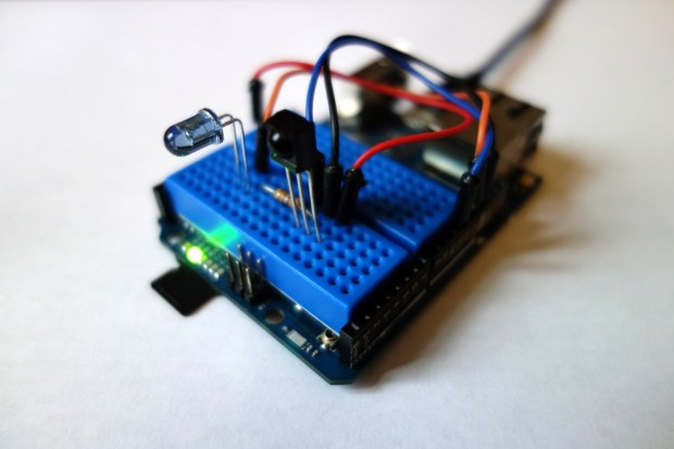 A mini breadboard fits perfectly snug between the Arduino Yún's header sockets.