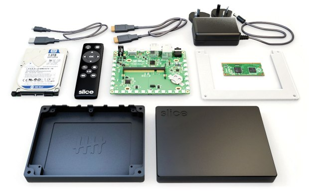 Opened up, Slice reveals a 1 terabyte hard drive, a Raspberry Pi Compute Module, and a custom-designed.