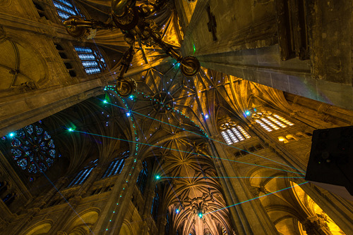 The interactive laser display is being featured at the Saint-Eustache Church in Paris.