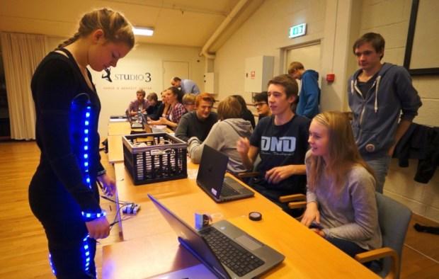 Each dancer had three students programming her costume. The dancer Nora Kveum was programmed by Kristoffer Nyvoll, Idunn Haavengen og Even Thonhaugen Røraas(standing)  Photographer:  Jan Dyre Bjerknes