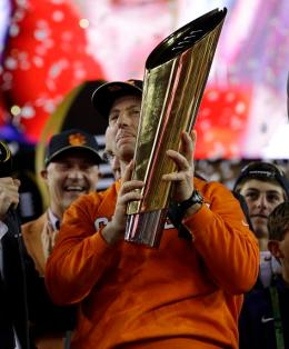 Clemson head coach Dabo Swinney holds the championship trophy after the NCAA college football playoff championship game against Alabama Tuesday, Jan. 10, 2017, in Tampa, Fla. Clemson won 35-31. (AP Photo/David J. Phillip)