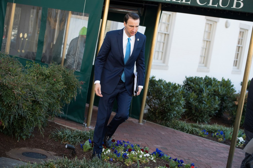 Rep. Ryan Costello, R-Pa., leaves a meeting of the House Republican Conference at the Capitol Hill Club on Wednesday. The sidewalk was blocked by a media scrum so he detoured through the flowerbed. (Tom Williams/CQ Roll Call)