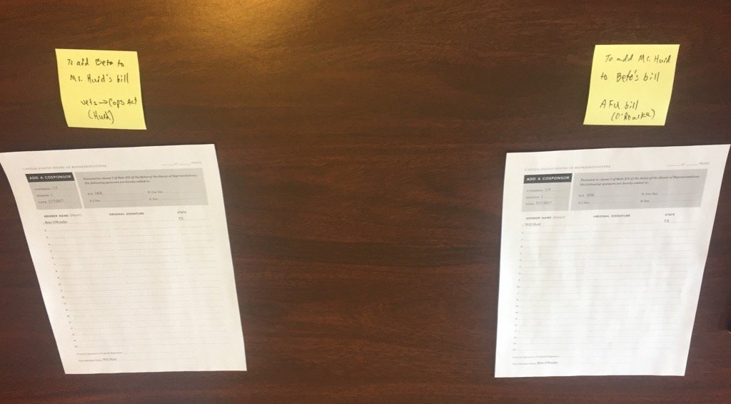 The two bills before they signed them. (Alex Gangitano/ CQ Roll Call)