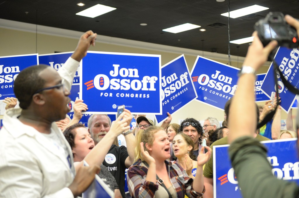 Volunteers show their support for Ossoff at a rally on the eve of last week's election. (Simone Pathé/CQ Roll Call).