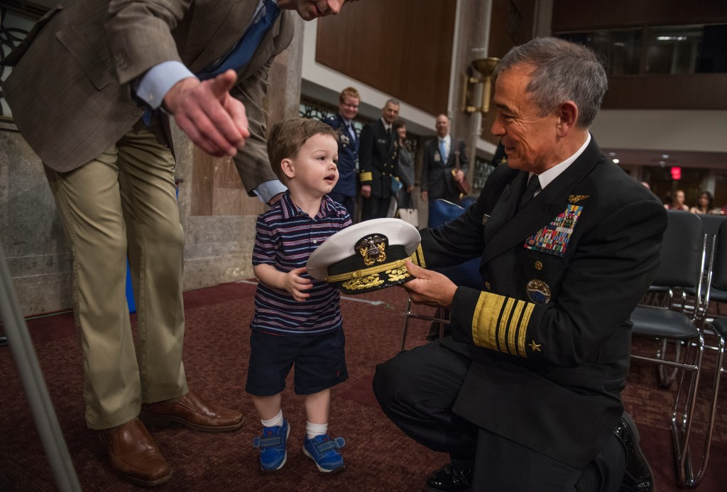 UNITED STATES - APRIL 27: Navy Adm. Harry Harris Jr., commander of the U.S. Pacific Command, greets Sen. Tom Cotton, R-Ark., and his son Gabriel, 2, before Harris testified at a Senate Armed Services Committee hearing in Dirksen Building titled