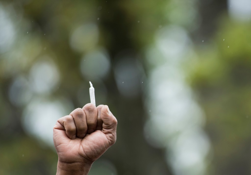 UNITED STATES - APRIL 24: A man holds a marijuana joint in his clenched fit during the DCMJ.org marijuana protest in front of the U.S. Capitol on Monday, April 24, 2017. The group held their protest to call on Congress to reschedule the drug classification of marijuana. (Photo By Bill Clark/CQ Roll Call)