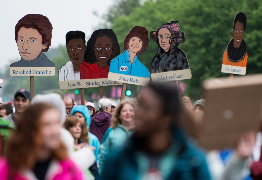 UNITED STATES - APRIL 22: Marchers carry portraits of women scientists down Constitution Avenue in Washington during the March for Science on Earth Day, Saturday, April 22, 2017. Thousands of pro-science and environmental activists rallied on the National Mall before marching towards the Capitol. (Photo By Bill Clark/CQ Roll Call)