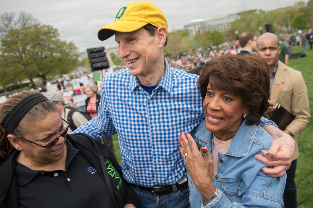 Rep. Maxine Waters, D-Calif., right, and Sen. Ron Wyden, D-Ore., attend the march. (Tom Williams/CQ Roll Call)