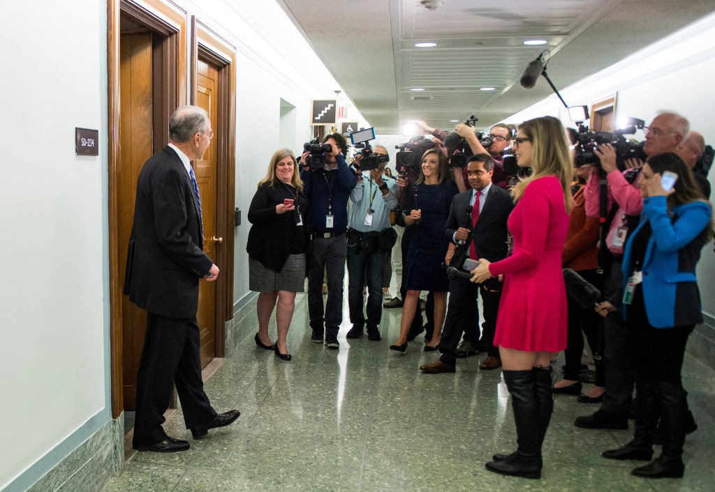 Judiciary chairman Sen. Chuck Grassley, R-Iowa, is greeted by cameras as he leaves the Senate Judiciary Committee hearing room on Wednesday. (Bill Clark/CQ Roll Call)
