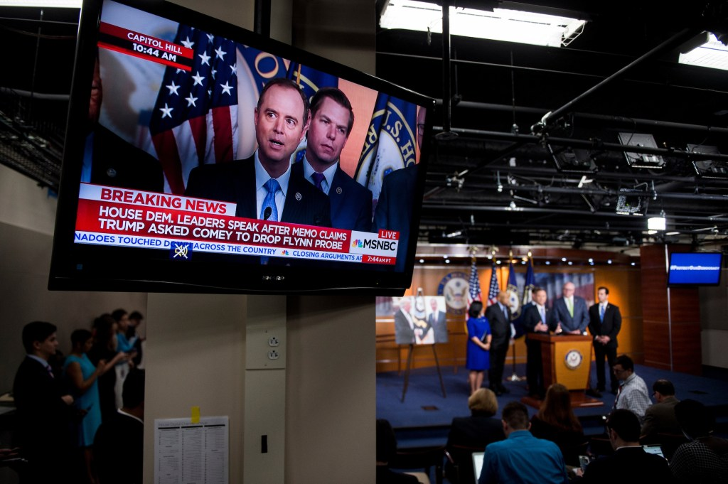 House Intelligence ranking member Adam Schiff and fellow California Rep. Eric Swalwell appear on a live broadcast of the House Democrats' news conference on President Donald Trump and alleged Russia ties. Other participants in the news conference were House Oversight and Government Reform ranking member Elijah E. Cummings of Maryland, House Democratic Caucus Chairman Joseph Crowley, Washington Rep. Pramila Jayapal, and Nevada Rep. Ruben Kihuen. (Bill Clark/CQ Roll Call)