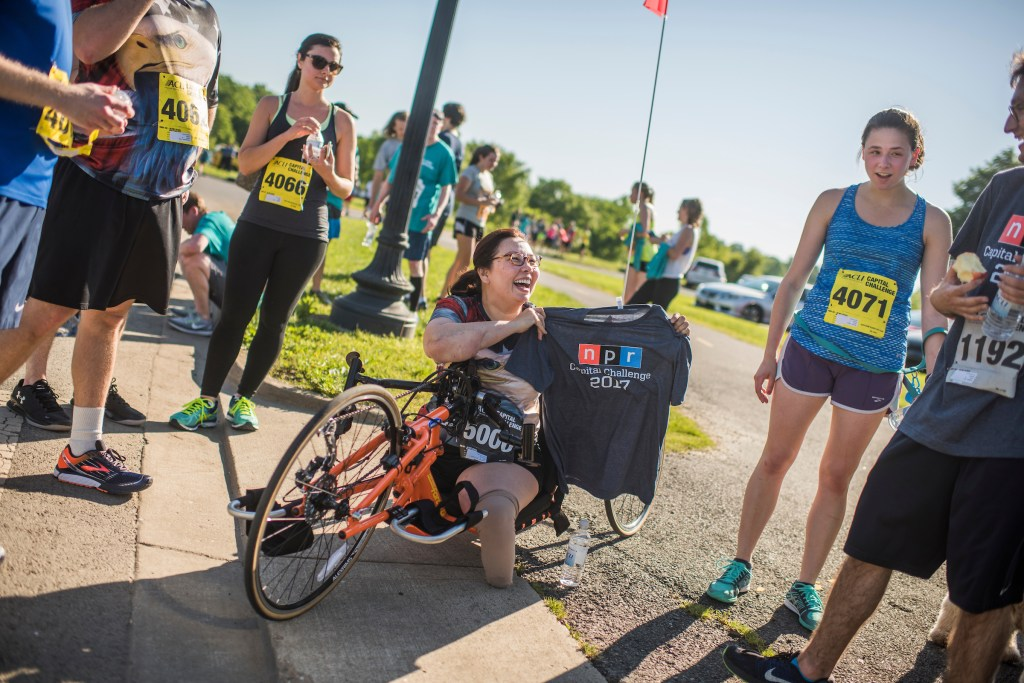 UNITED STATES - MAY 17: Sen. Tammy Duckworth, D-Ill., receives a shirt from the NPR team after the ACLI Capital Challenge 3 Mile Team Race in Anacostia Park, May 17, 2017. (Photo By Tom Williams/CQ Roll Call)