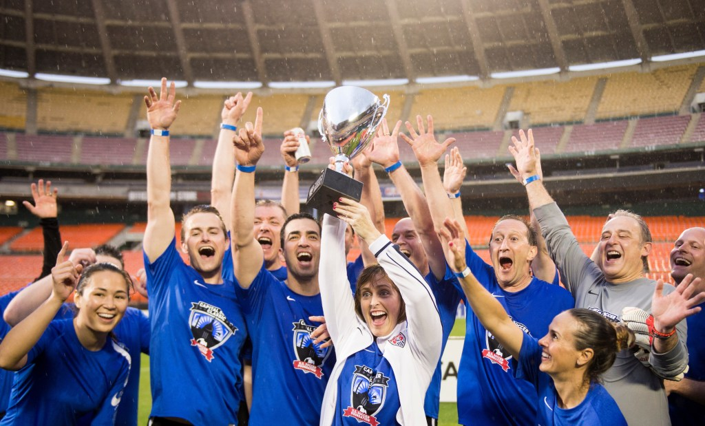 Democrats hoist their trophy after defeating the Republicans 5-3. (Bill Clark/CQ Roll Call)