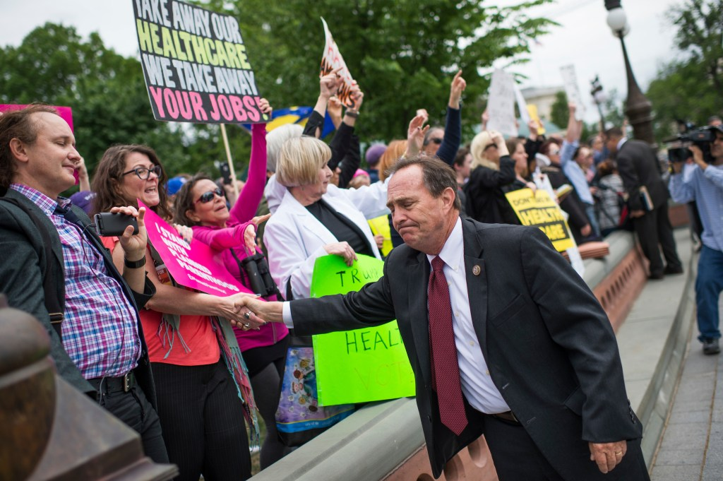 UNITED STATES - MAY 4: Rep. Ed Perlmutter, D-Colo., greets protesters on the East Front of the Capitol after the House passed the Republicans' bill to repeal and replace the Affordable Care Act on May 4, 2017. The protesters support the ACA. (Photo By Tom Williams/CQ Roll Call)