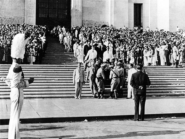 Huey Long's casket is carried down the steps of the Louisiana State capitol.