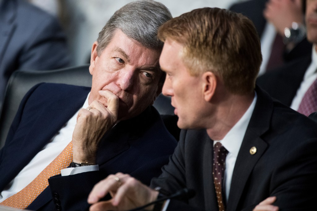 UNITED STATES - JUNE 8: Sen. Roy Blunt, R-Mo., left, and Sen. James Lankford, R-Okla., talk as former FBI Director James Comey testifies during the Senate Select Intelligence Committee hearing on