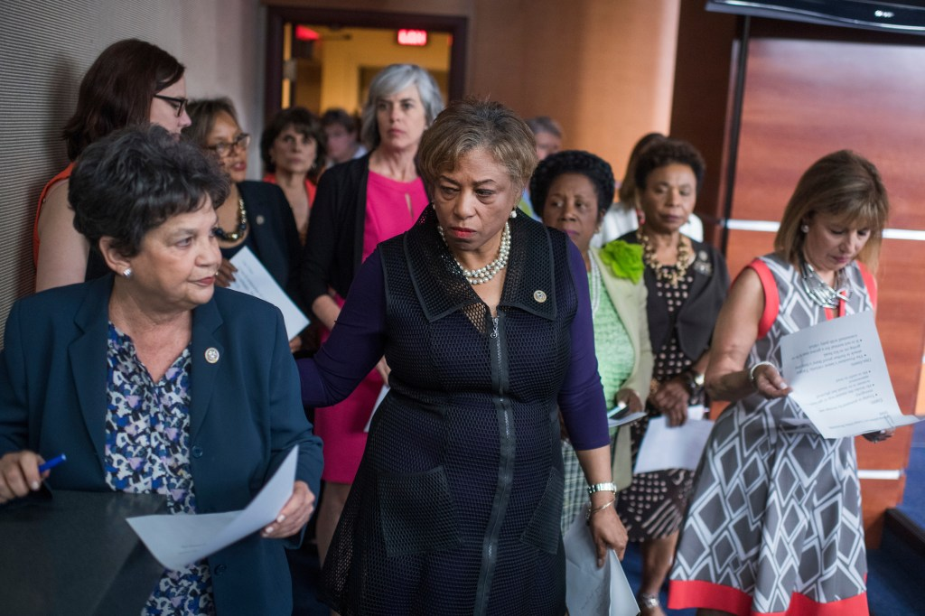 Reps. Brenda Lawrence, D-Mich., center, Rosa DeLauro, D-Conn., Lois Frankel, D-Fla., and other members of the Democratic caucus begin a news conference in the House studio to denounce President Trump's tweets regarding women on June 29, 2017. (Photo By Tom Williams/CQ Roll Call)