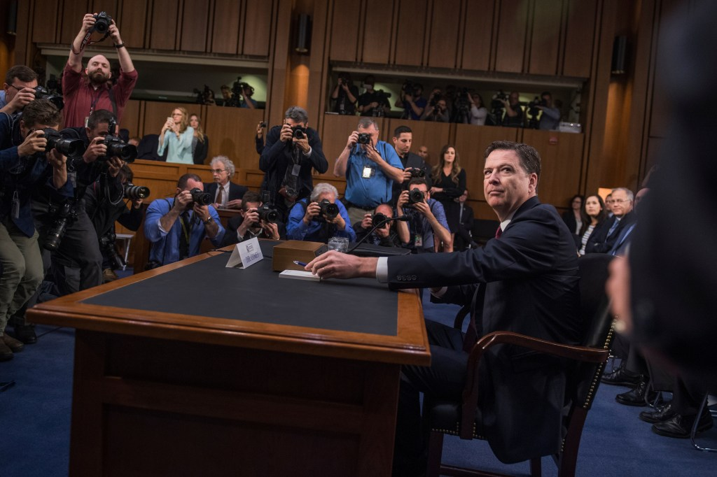 UNITED STATES - JUNE 8: Former FBI Director James Comey arrives to testify about President Trump's possible campaign ties to Russia before a Senate Select Intelligence Committee hearing on June 8, 2017. (Photo By Tom Williams/CQ Roll Call)