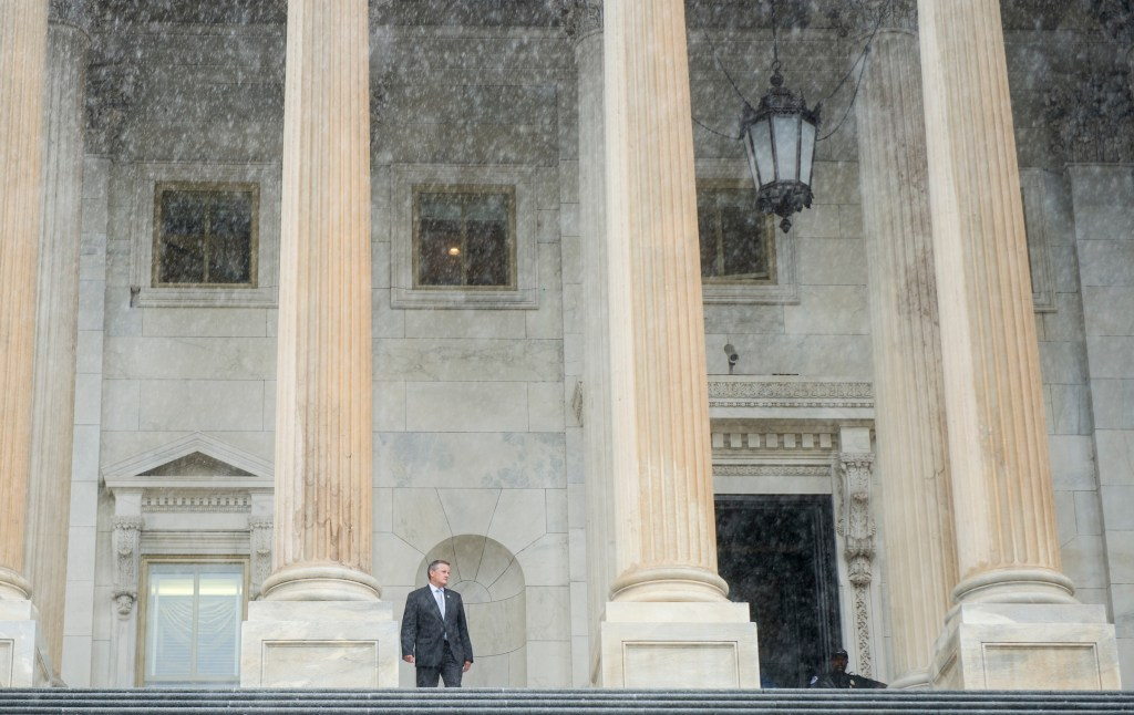 UNITED STATES - JULY 28: Rep. Bruce Westerman, R-Ark., prepares to walk down the House steps in the pouring rain following the final votes as Congress leaves town for their summer recess on Friday, July 28, 2017. (Photo By Bill Clark/CQ Roll Call)