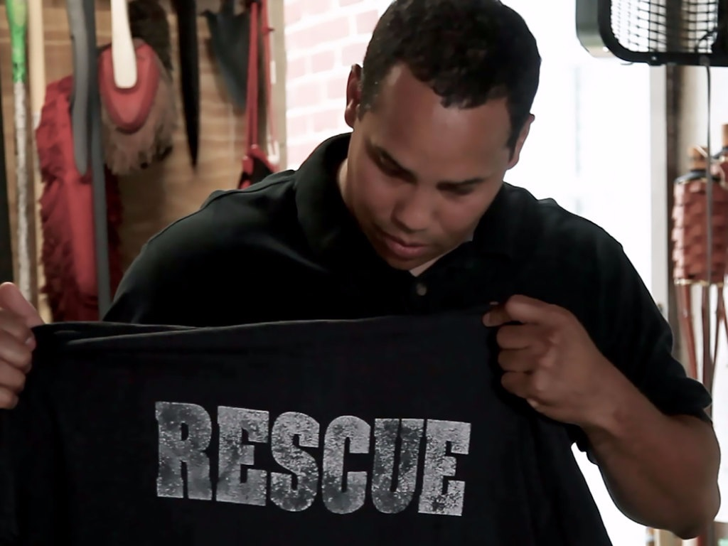Frederico A. Ruiz with the shirt he wore on 9/11. (Screenshot)