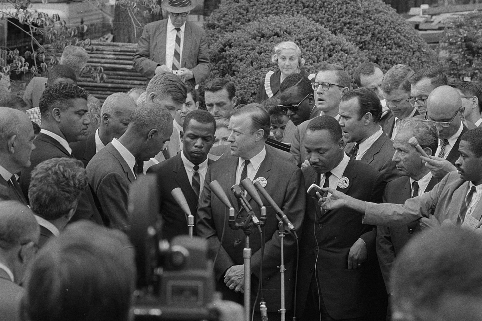 King, Lewis, center, and civil rights leaders talk with reporters after meeting with President John F. Kennedy after the March on Washington, D.C. (Photo by Warren K. Leffler, courtesy the Library of Congress Prints and Photographs Division.)