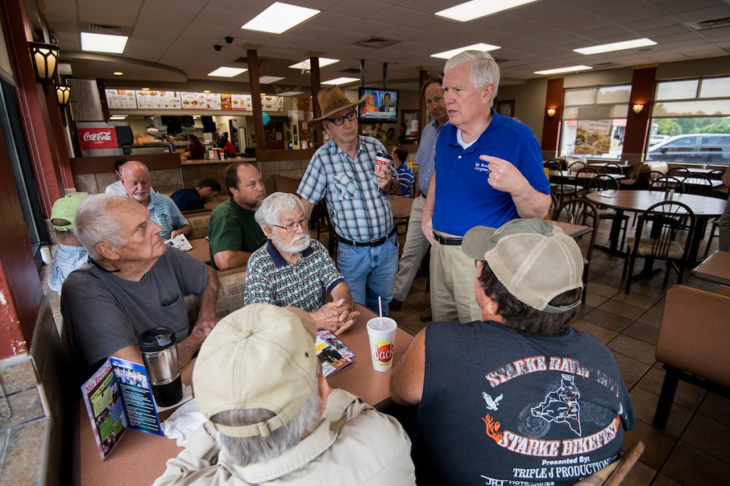 Brooks speaks with diners at Jack's, a hamburger chain restaurant, during a bus tour stop in Munford, Alabama. (Bill Clark/CQ Roll Call)
