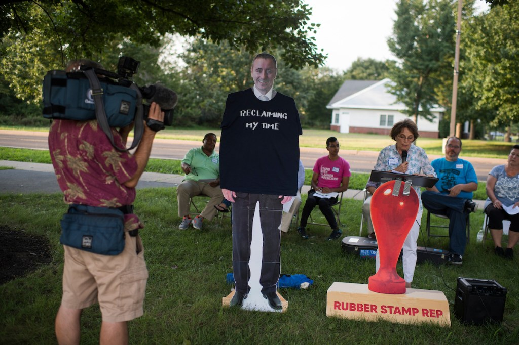 A cutout of Rep. Brian Fitzpatrick, R-Pa., appears at protest outside of his town hall meeting in Bensalem, Pa. (Tom Williams/CQ Roll Call)