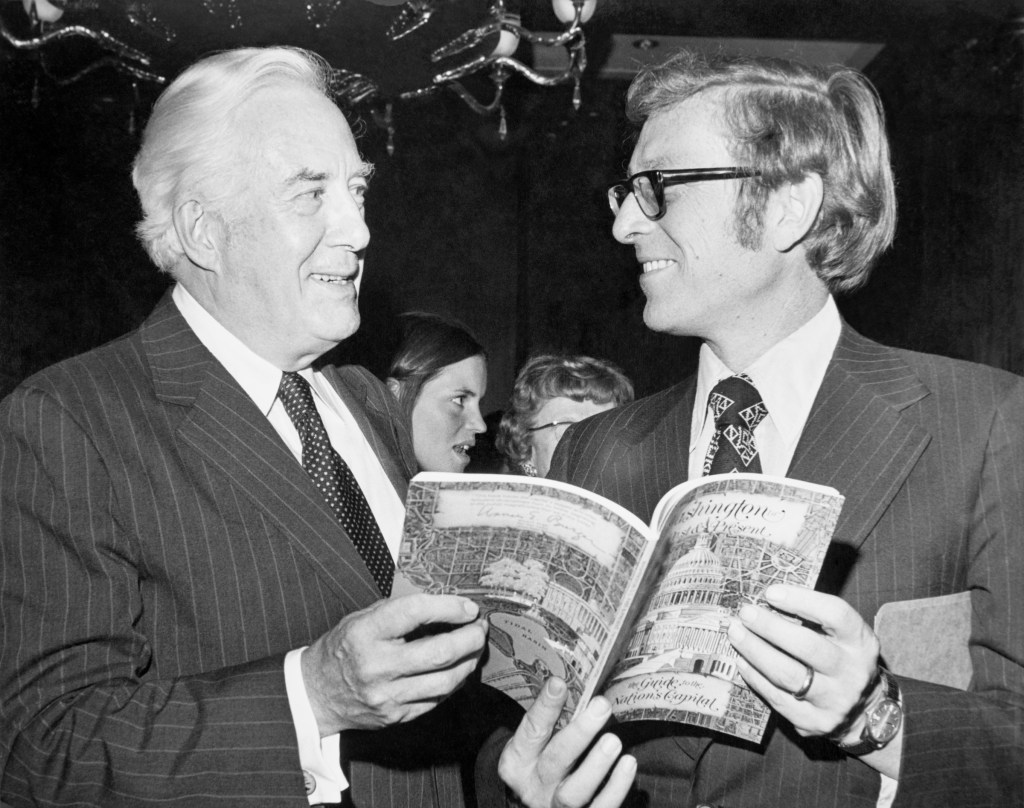 Chief Justice Warren Burger with Sen. Pete Domenici, R-N.M., talking over a book at the Capitol Hill Reception for the New Washington Guide Book in 1975. (Photo by CQ Roll Call)
