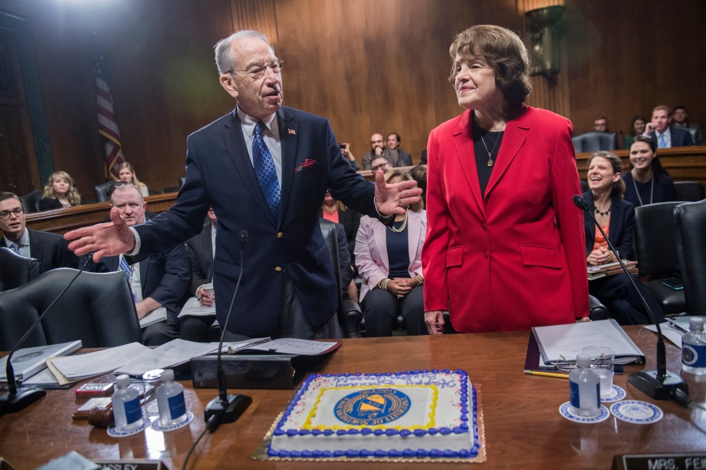 UNITED STATES - SEPTEMBER 14: Chairman Charles Grassley, R-Iowa, is presented a cake to celebrate his 63rd wedding anniversary and his upcoming birthday as Sen. Dianne Feinstein, D-Calif., ranking member, looks on during Senate Judiciary Committee markup in Dirksen on judicial nominations on September 14, 2017. (Photo By Tom Williams/CQ Roll Call)