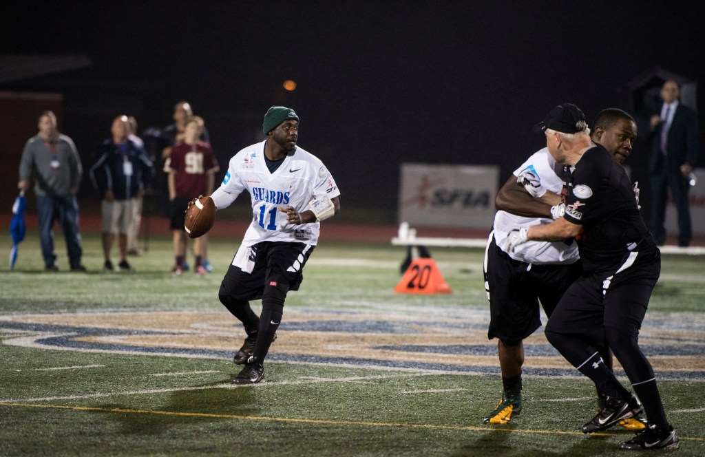 UNITED STATES - OCTOBER 11: The Guards' quarterback Reggie Tyson drops back to pass during the Congressional Football Game at Gallaudet University in Washington on Wednesday, Oct. 11, 2017. The game featured the Capitol Police team The Guards vs the Congressional team The Mean Machine. (Photo By Bill Clark/CQ Roll Call)