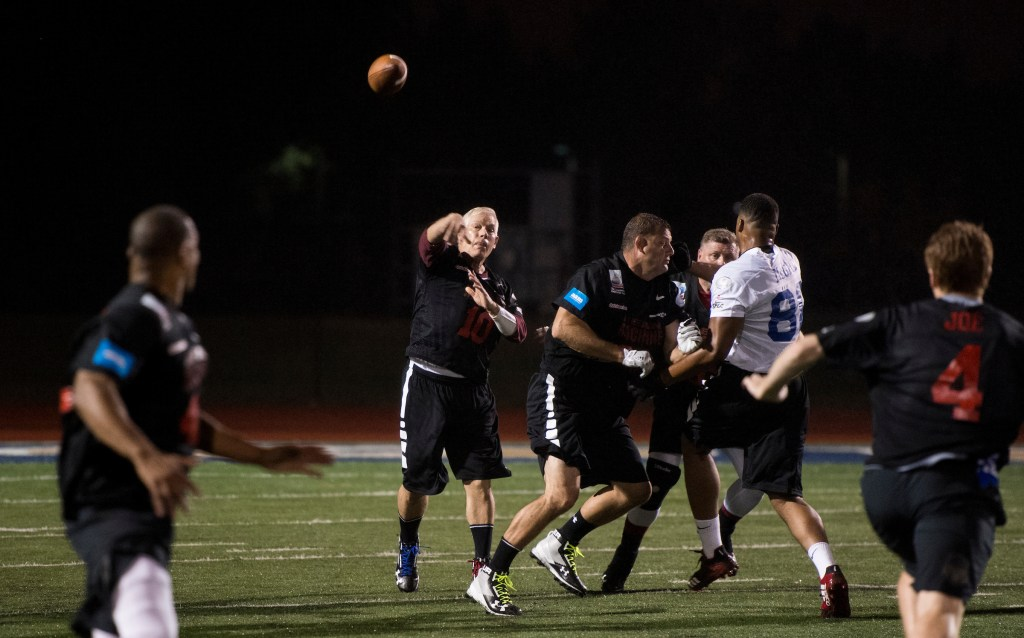 UNITED STATES - OCTOBER 11: Rep. Pete Sessions, R-Texas, passes during the Congressional Football Game at Gallaudet University in Washington on Wednesday, Oct. 11, 2017. The game featured the Capitol Police team The Guards vs the Congressional team The Mean Machine. (Photo By Bill Clark/CQ Roll Call)