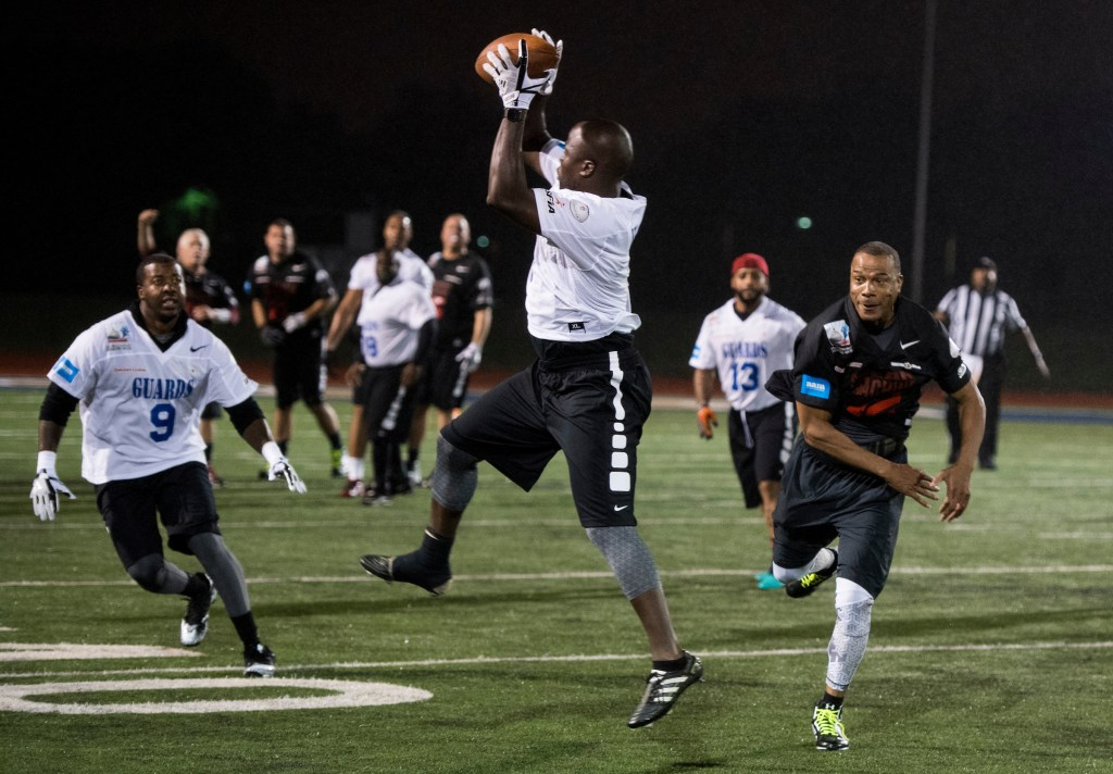 UNITED STATES - OCTOBER 11: The Guars' Milton Harris intercepts a pass and returns the ball for a touchdown during the Congressional Football Game at Gallaudet University in Washington on Wednesday, Oct. 11, 2017. The game featured the Capitol Police team The Guards vs the Congressional team The Mean Machine. (Photo By Bill Clark/CQ Roll Call)