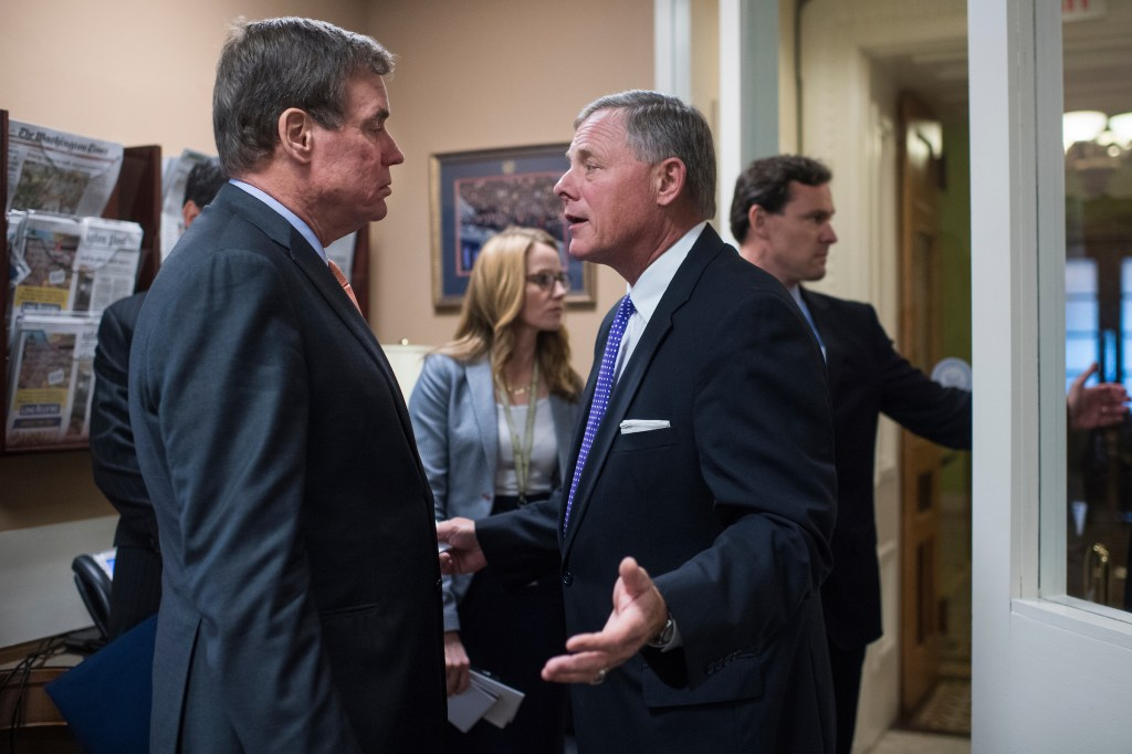 UNITED STATES - OCTOBER 04: Senate Intelligence Committee Chairman Richard Burr, R-N.C., right, and Vice Chair Mark Warner, D-Va., prepare for a news conference in the Capitol to give an update on the investigation into Russian interference in the 2016 election on October 4, 2017. (Photo By Tom Williams/CQ Roll Call)