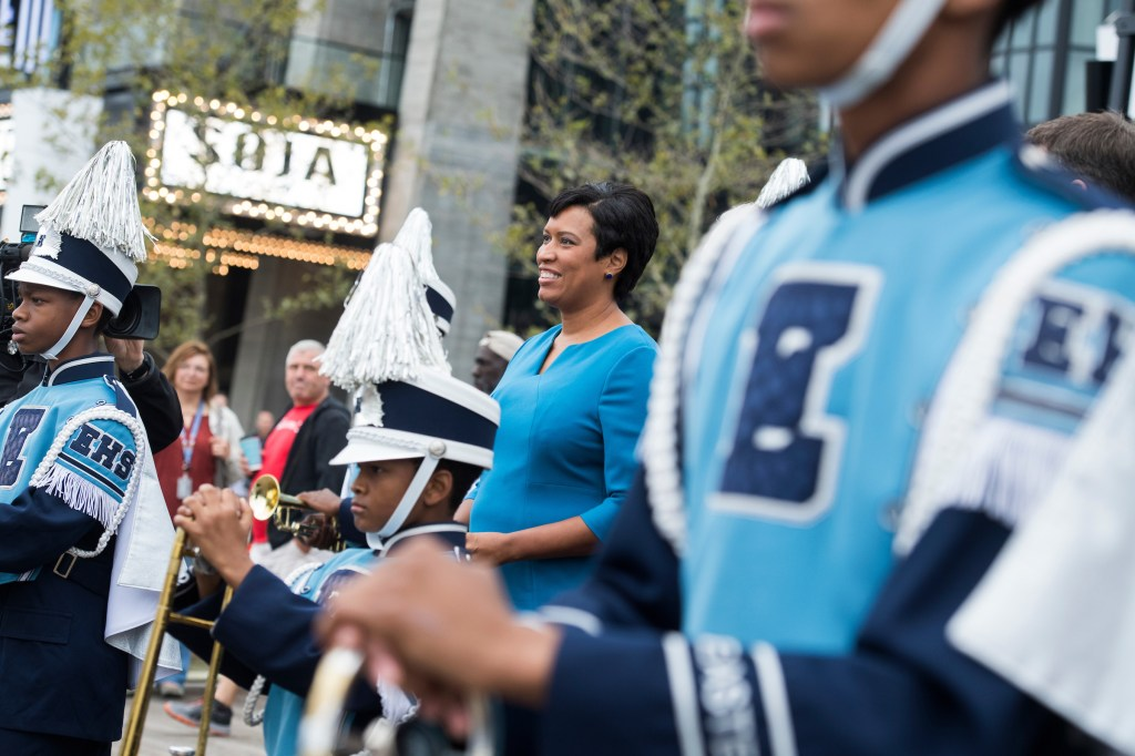 UNITED STATES - OCTOBER 12: DC Mayor Muriel Bowser appears with the Eastern High School marching band during the opening ceremony of the Wharf complex along Maine Avenue, SW, on October 12, 2017. (Photo By Tom Williams/CQ Roll Call)