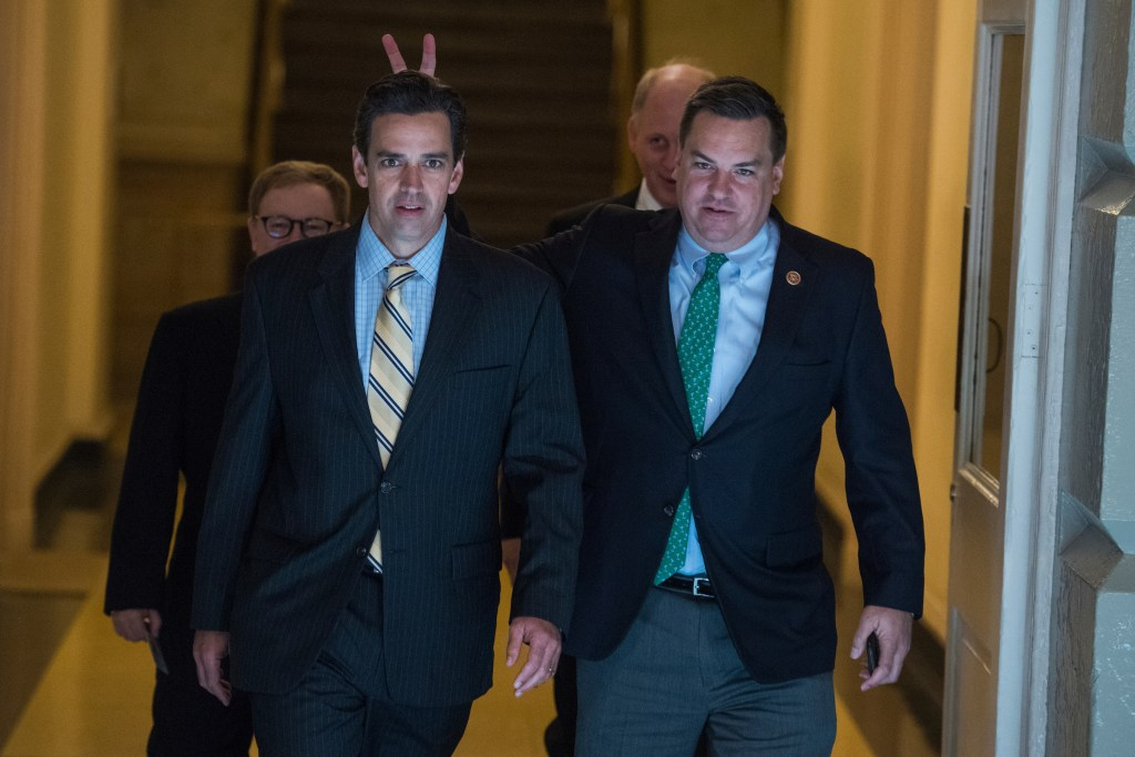 Rep. Richard Hudson, R-N.C., right, gives Rep. Tom Graves, R-Ga., bunny ears as they make their way to a meeting with Trump on taxes. (Tom Williams/CQ Roll Call)