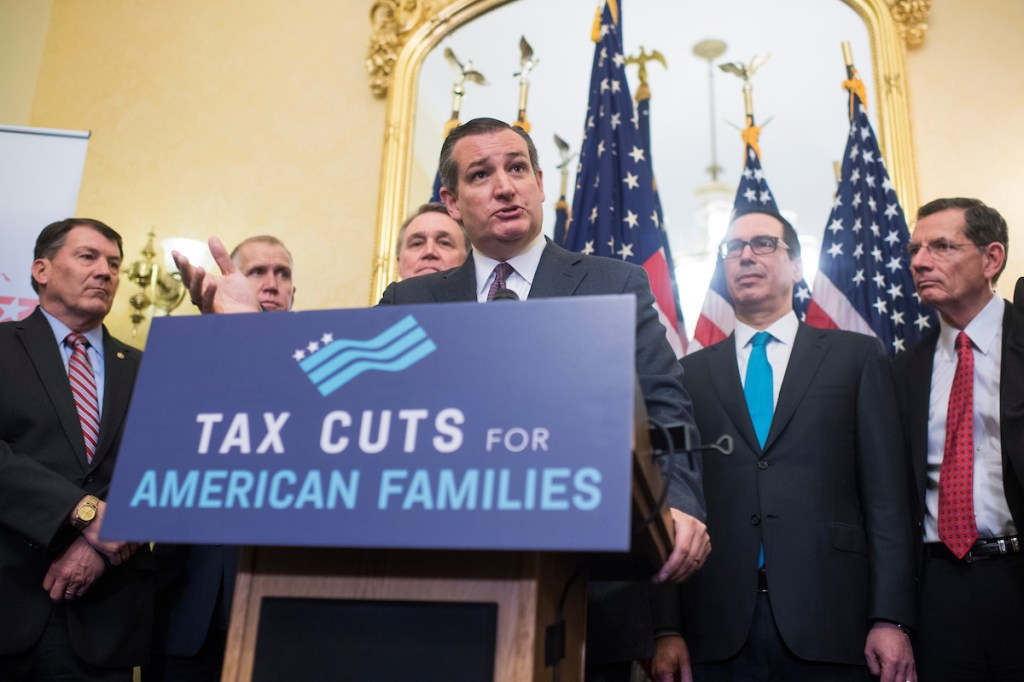 UNITED STATES - NOVEMBER 07: Sen. Ted Cruz, R-Texas, speaks during a news conference in the Capitol where GOP senators said families and small businesses would benefit from tax reform on November 7, 2017. Appearing behind him are, from left, Sens. Mike Rounds, R-S.D., Thom Tillis, R-N.C., David Perdue, R-Ga., Treasury Secretary Steven Mnuchin, and John Barrasso, R-Wyo. Administration officials and tax experts also voiced support for reform. (Photo By Tom Williams/CQ Roll Call)