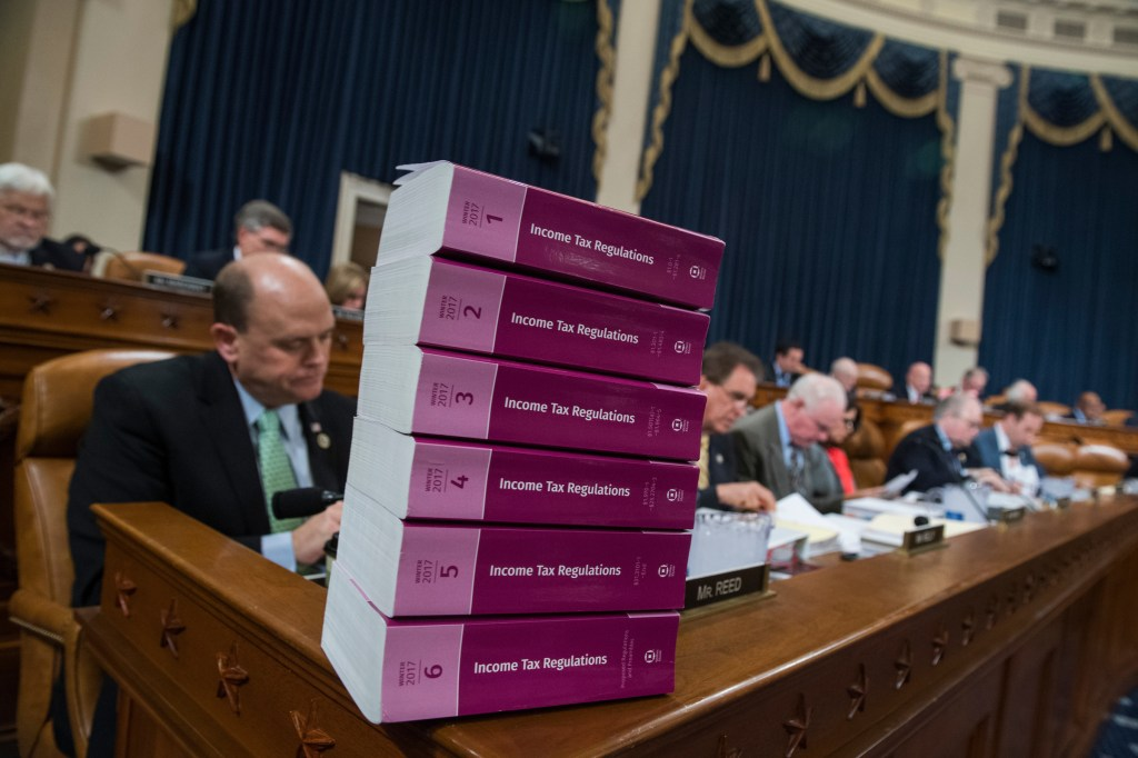 UNITED STATES - NOVEMBER 06: A stack of the current income tax regulations sits on the dais during a House Ways and Means Committee markup of the Republicans' tax reform plan titled the Tax Cuts and Jobs Act, in Longworth Building on November 6, 2017. (Photo By Tom Williams/CQ Roll Call)