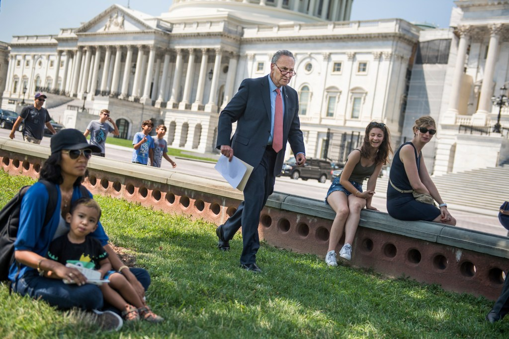 UNITED STATES - AUGUST 02: Senate Minority Leader Charles Schumer, D-N.Y., returns after a phone call to a news conference on the east lawn of the Capitol to unveil a new economic agenda titled