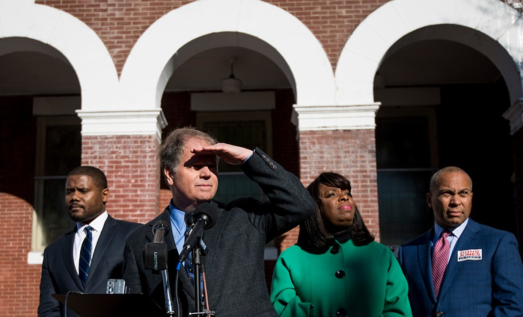 Jones speaks, flanked from left by Selma Mayor Darrio Melton, Rep. Terri Sewell, D-Ala., and former Gov. Deval Patrick, D-Mass., outside of the Brown Chapel AME Church in Selma, Ala. (Bill Clark/CQ Roll Call)