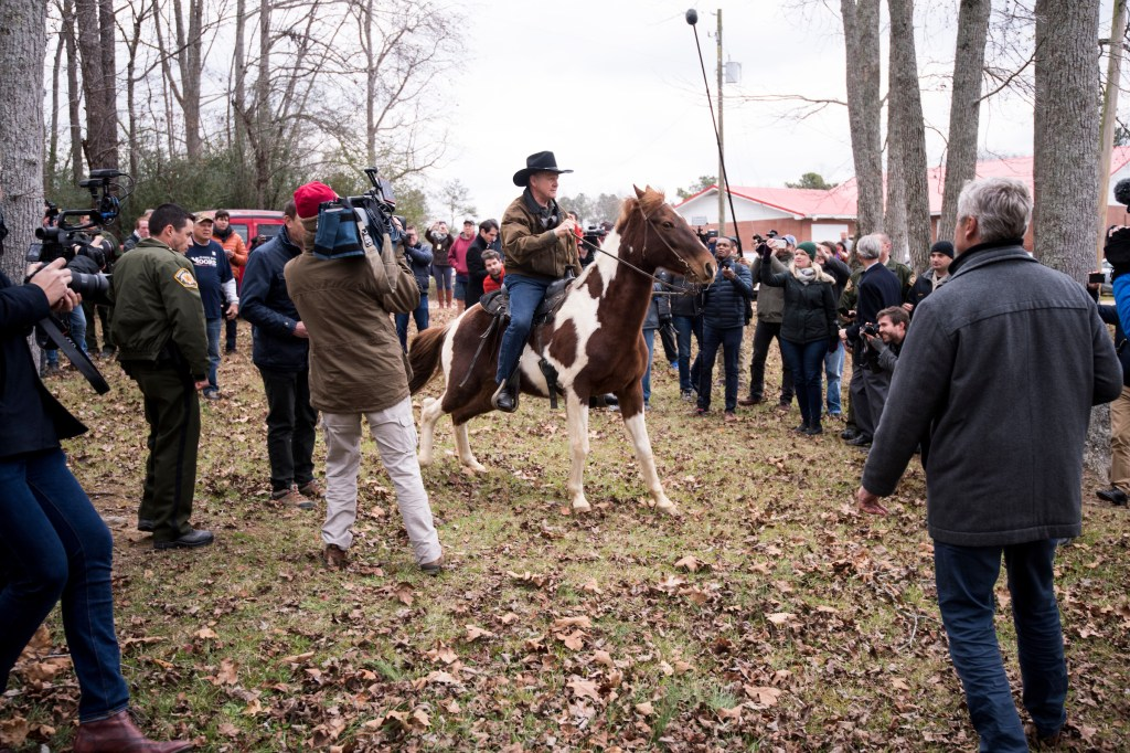 UNITED STATES - DECEMBER 11: Judge Roy Moore rides away on his horse after voting at the Gallant Volunteer Fire Department in Gallant, Ala., on Tuesday, Dec. 12, 2017. (Photo By Bill Clark/CQ Roll Call)