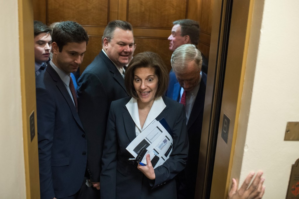 UNITED STATES - DECEMBER 05: Sen. Catherine Cortez Masto, D-Nev., boards an elevator before the Senate Policy luncheons in the Capitol on December 5, 2017. Sens. Jon Tester, D-Mont., third from left, Angus King, I-Maine, right, and Mark Warner, D-Va., are also pictured. (Photo By Tom Williams/CQ Roll Call)