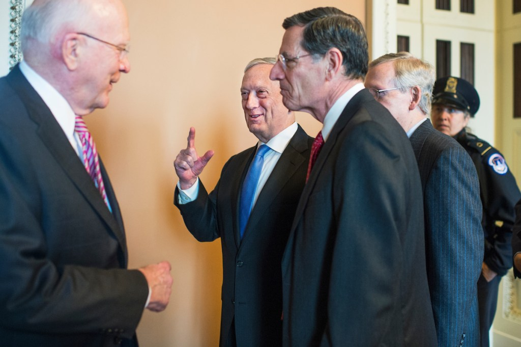 UNITED STATES - JANUARY 09: From left, Sen. Patrick Leahy, D-Vt., Defense Secretary James Mattis, Sen. John Barrasso, R-Wyo., and Senate Majority Leader Mitch McConnell, R-Ky., are seen outside the Republican Senate Policy luncheon in the Capitol on January 9, 2018. (Photo By Tom Williams/CQ Roll Call)