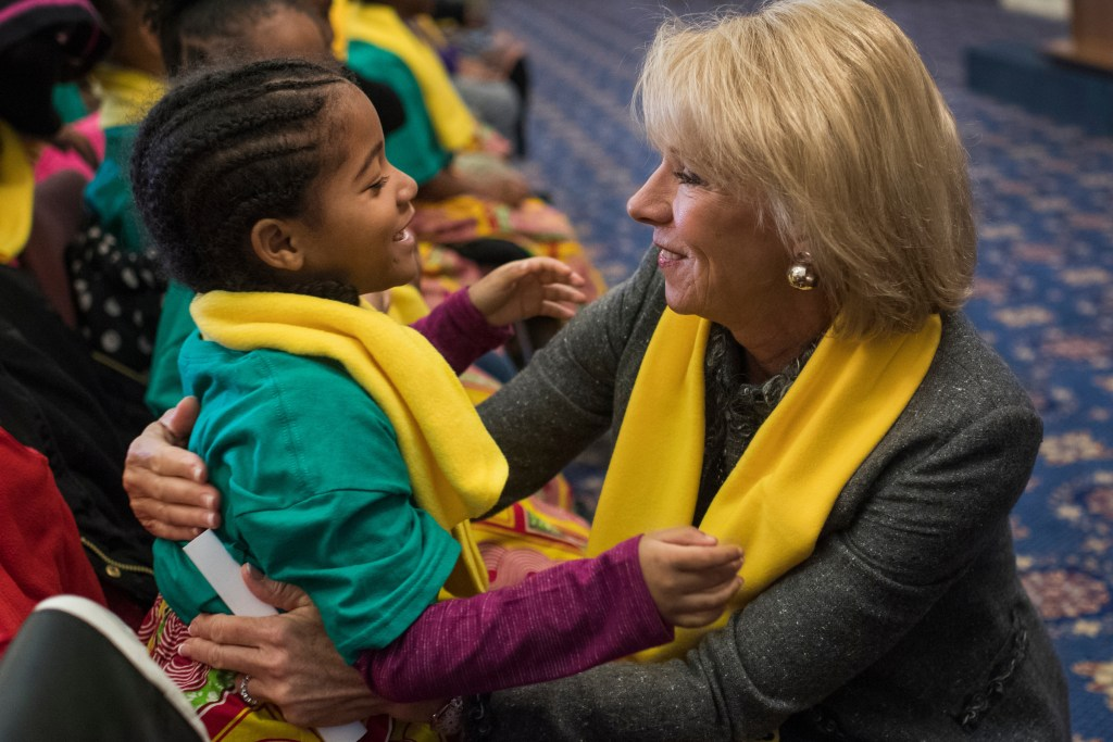 UNITED STATES - JANUARY 18: Education Secretary Betsy DeVos greets Arielle Jordan, 6, of the District's Kuumba Preparatory School of the Arts, during a rally to promote the importance of school choice as part of