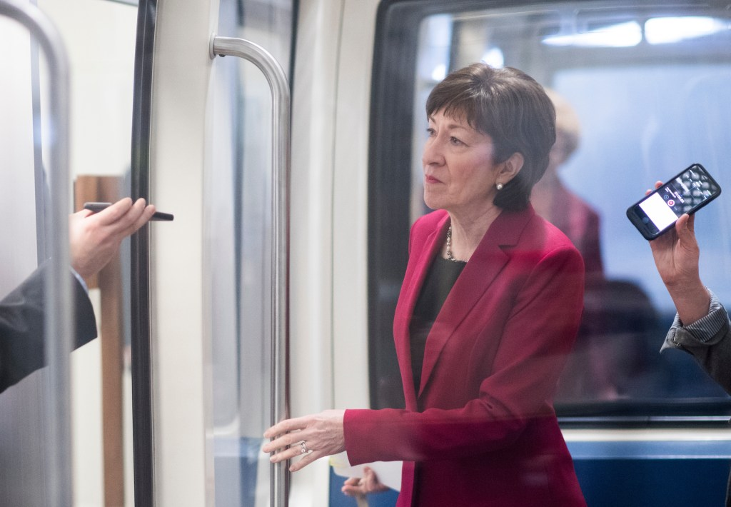 Sen. Susan Collins, R-Maine, speaks to reporters as she boards the Senate subway in the Capitol on Tuesday, Feb. 6, 2018. (Photo By Bill Clark/CQ Roll Call)